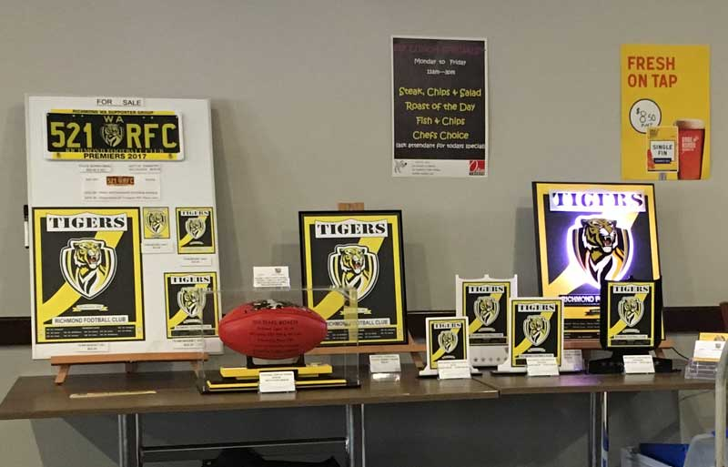 Showing Richmond Tigers Memorabilia for sale at a Richmond Tigers Supporter Group Function. Signed Richmond Shirrin Football, number plates, plaques and other Tiger Merchandise